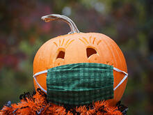 jack-o-lantern wearing a face mask