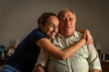 Loved one hugging aging senior adult