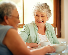 Two seniors laughing together