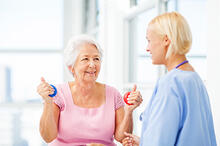 Senior exercising with an occupational therapist